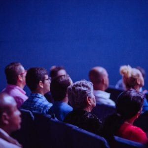 people sitting in audience for conference presentation