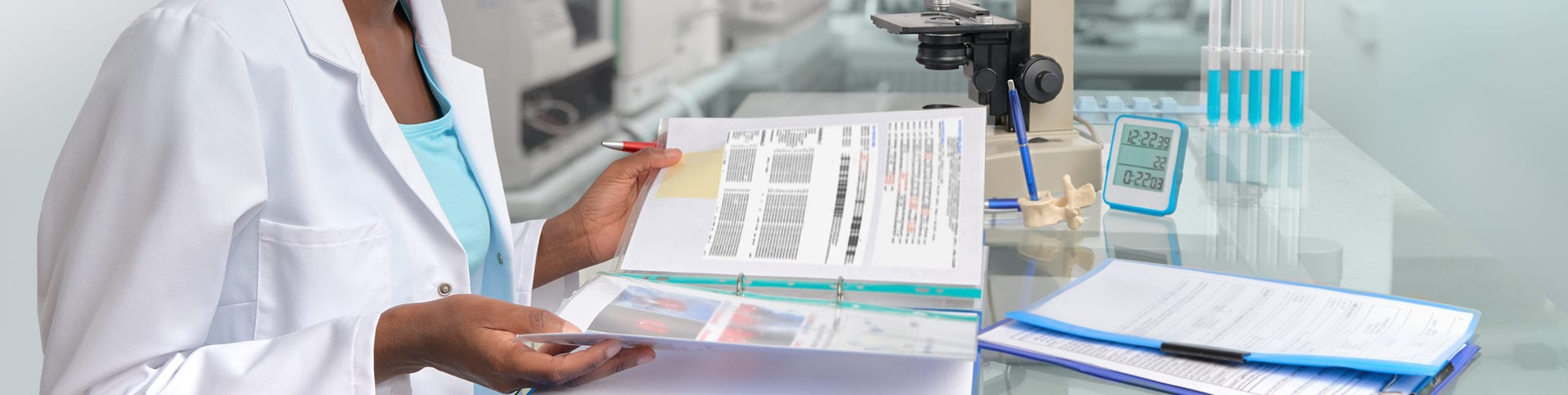 college age african american female reading notes in science lab